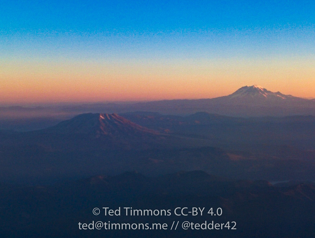 Sunrise, Mt. St. Hood, and Mt. Adams(?) from the plane.