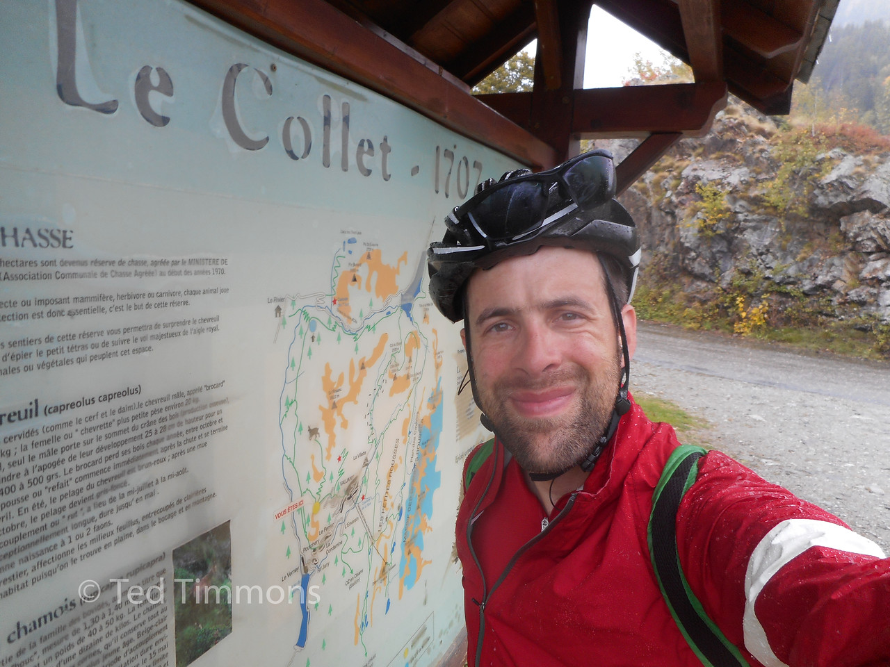 "At the top of the Le Collet du Perrier climb. (""shoulder of Perrier mountain"", basically a ridgeline). It has been raining hard for a while, I'm wet and not entirely warm."