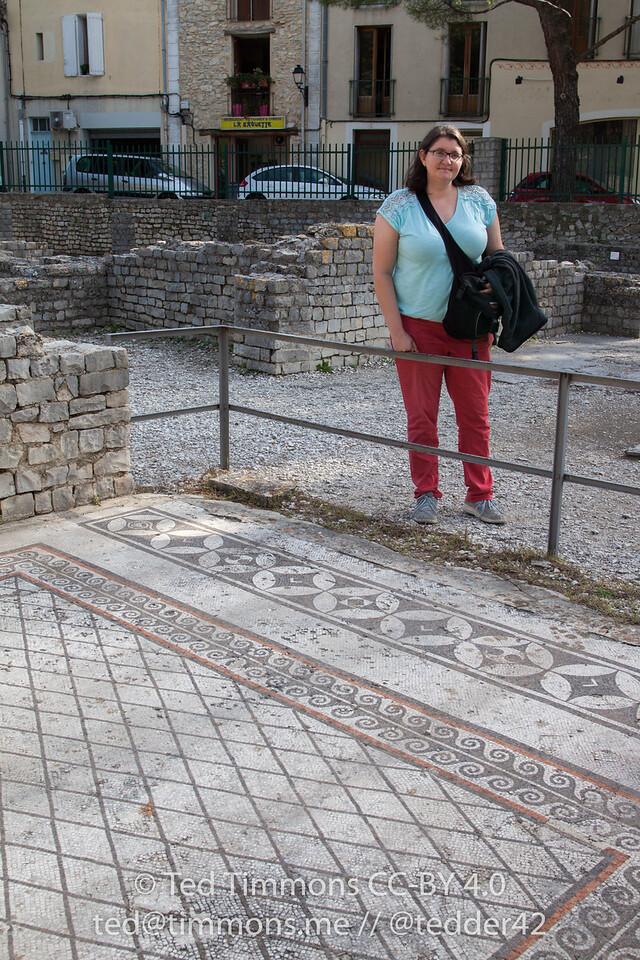 Faye in the Roman ruins in Vaison-la-Romaine near mosaic floor