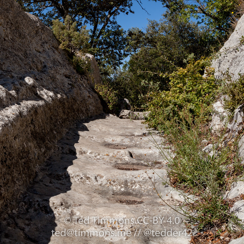 Path up the cliff to the fort. Carved steps cut out of the limestone cliffs with lots of wear.