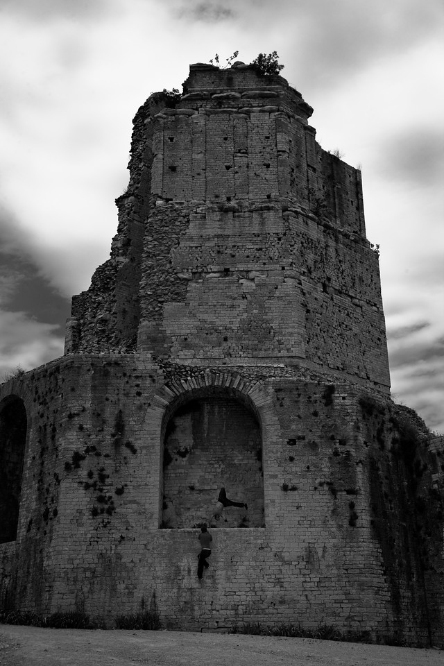 These teenagers were happy to show off for the camera. This ancient Roman tower sits on top of a hill overlooking Nîmes.