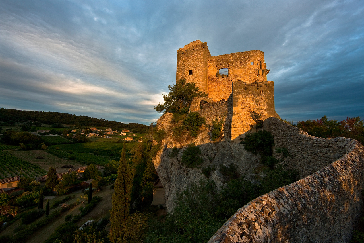 """Ah, the golden hour. Just as I was ignoring the sign which said """"Do not sit on this wall because you will fall off the cliff and break your face off"""" so that I could get this shot, the morning sun peeked out from behind a cloud."""