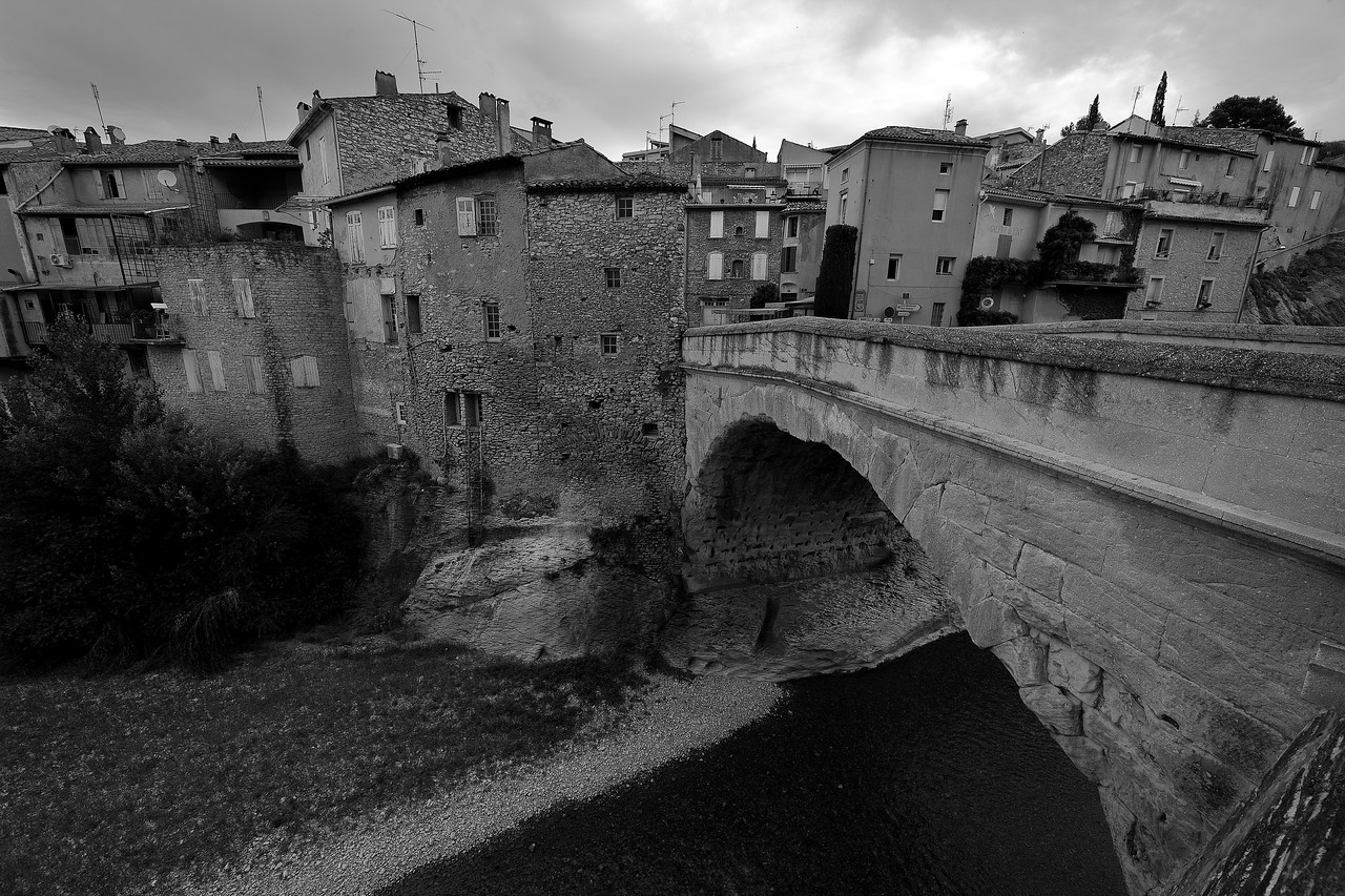 This is a bridge built by the Romans, and it's been in continuous use since its construction. It doesn't have mortar (it hadn't been invented yet), yet it survived 2,000 years of flooding, to include a flood in the 90s that carried away the more modern upper portion (not made by the Romans). You can see how well the stone blocks fit together. Pretty awesome.