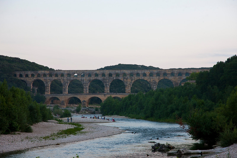 "Pont du Gard, the highlight of my trip—but it didn't start out that way. During my planning stages I specifically picked this location because it is the most incredible surviving example of Roman aqueducts, yet it's very un-touristy, essentially because it's not located in Rome. But as I entered the little town I found myself stuck in a traffic jam. When I finally got to the front the man directing traffic informed me that I wouldn't be able to visit Pont du Gard that evening because there was an open concert on the grounds, and I didn't have a ticket. (""What?!"" I thought. That's like saying ""Sorry, you won't be able to visit the Statue of Liberty today. Sorry about those 800 miles you drove."") ""We'll see about that,"" I ALSO thought..."