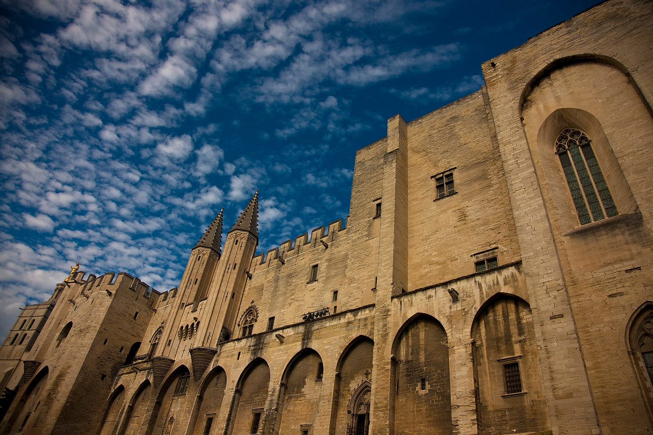 In the 14th century the Catholic church moved its headquarters from Rome to Avignon, where it remained for around a hundred years, transforming Avignon from a small town into a rich and beautiful city. This is the popes' palace. 