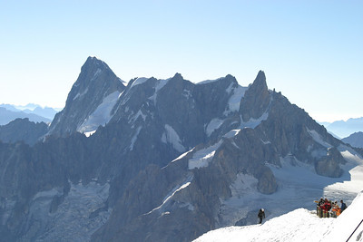 Climber returning to the Aiguille du Midi station, with the Grandes Jorasses in the background.
