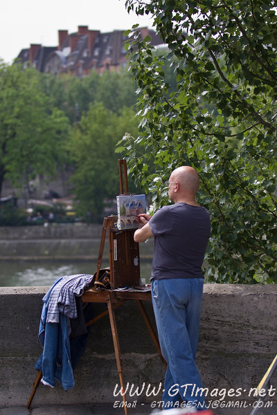 Paris - Many steet artists work on paintings of the beautiful city. They have booths along the Seine, and sell their art.