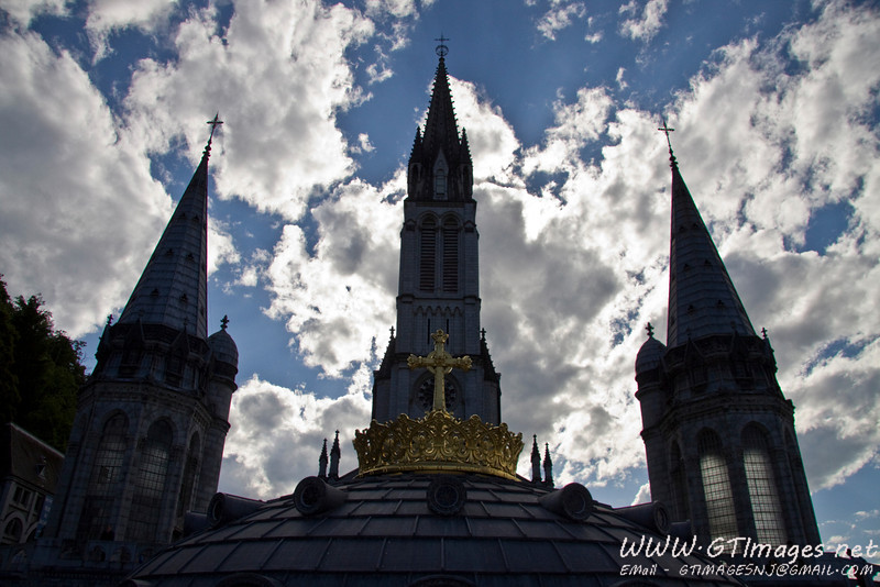 Lourdes France - top of the basilica dome and towers.