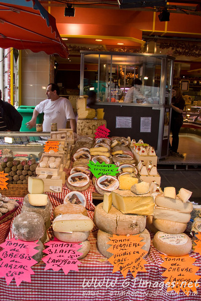 Paris - St. Germaine - street vendors sell many local foods such as sausages/cheeses/wines alongside the cafes.