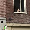 Little girl eating ice cream in the window across the street from where I was having dinner.
