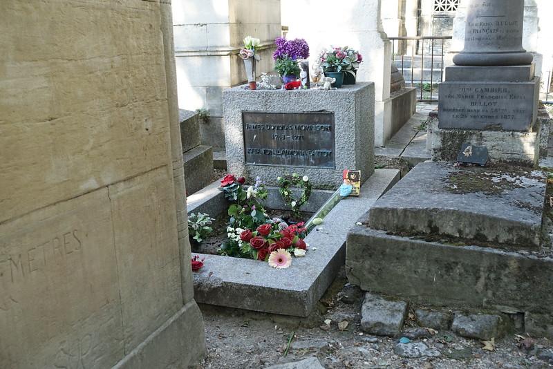 Jim Morrison's grave at Pere Lachaise Cemetery in Paris