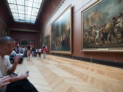 The Louvre is big, but some of the paintings seem too big to have been brought inside...