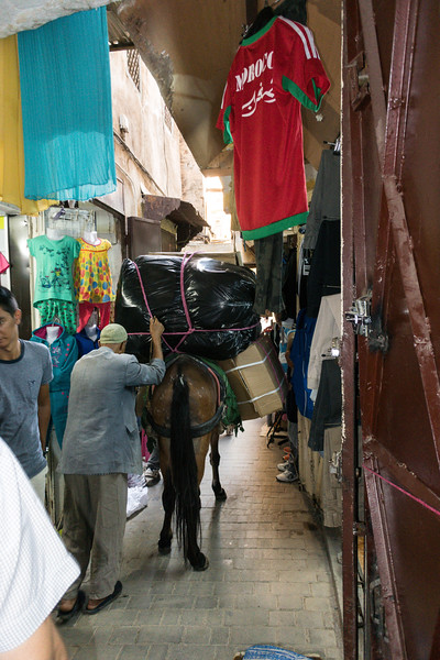 This guy got yelled at for overloading his donkey and for taking it down a much to narrow alley.