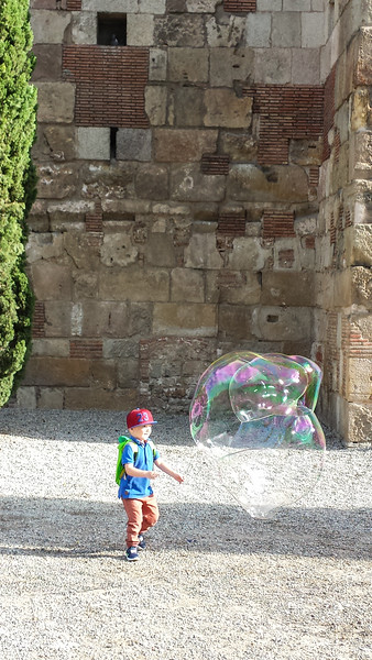 Near Basílica de Santa Maria del Pi in the old quarter of town I found this boy playing with the huge bubbles a guy was blowing.