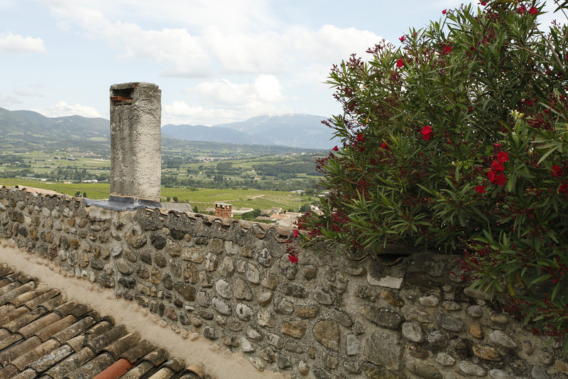 Flowers, stone, chimney and a beautiful view, Vinsobres, France.