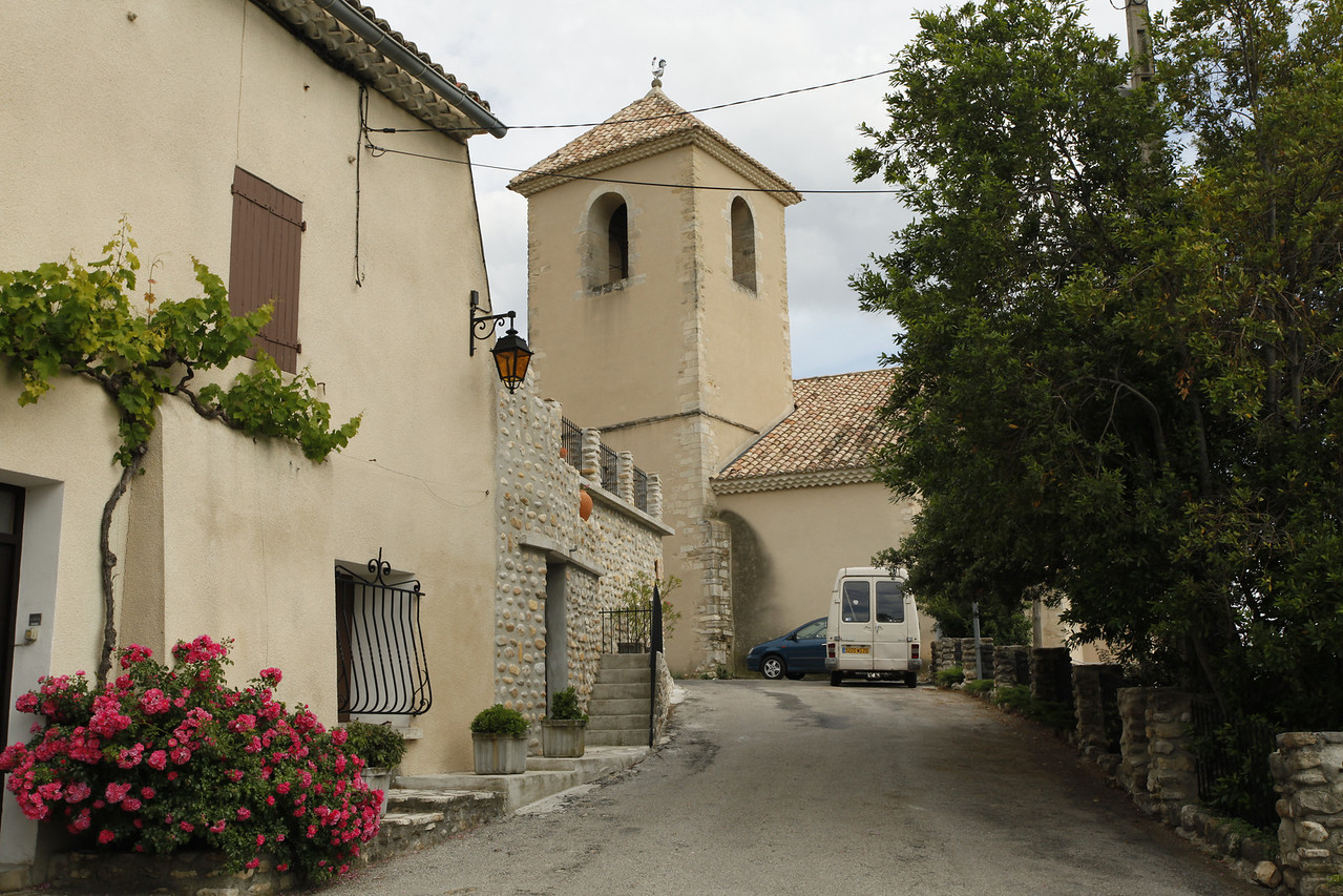 A bell tower with a rooster on top, Vinsobres, France.