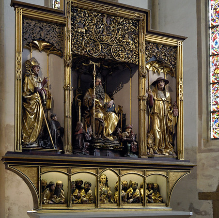 Isenheim altarpiece, Unterlinden Museum, Colmar, Alsace, 17 July 2005 7.   ...Niklaus Hagenaur's painted carving of St Anthony flanked by St Augustine (left) and St Jerome.  The predella, no longer covered by the painting of the Entombment, depicts Christ and the 12 Apostles.