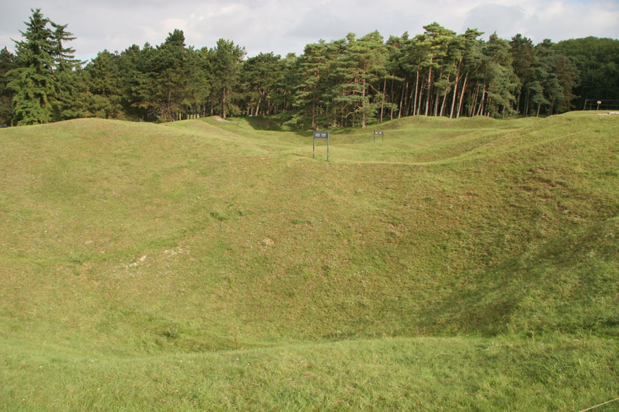 Loking across the front line at Vimy Ridge from the Canadian tenches to the German ones near the trees (which would be no more than 100 metres away).  Those are bomb craters in between.