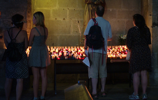 Votive candles in the very dark Carcassonne citadel church.