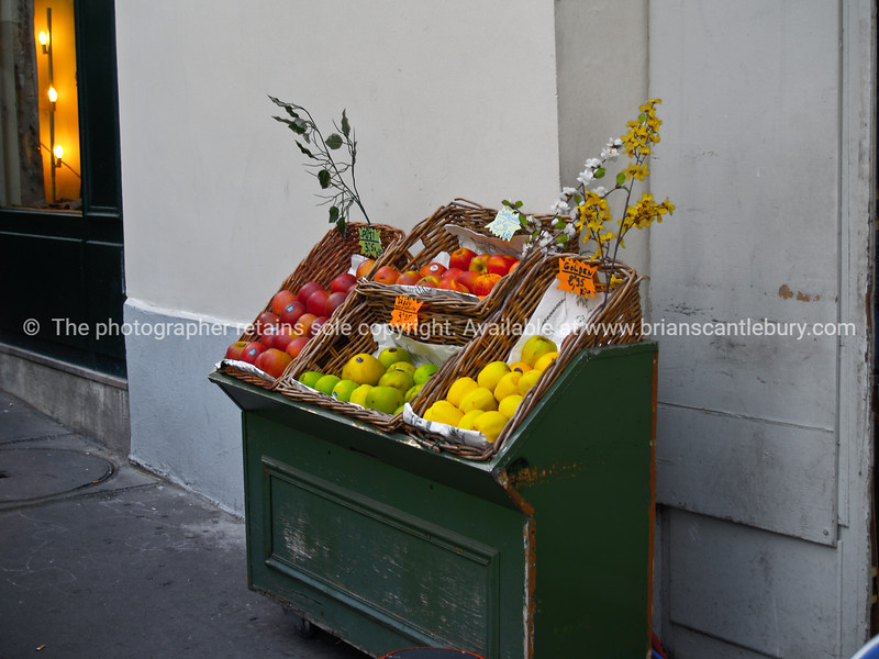 "Fruit stand in street. Montmatre, Paris, International City. SEE ALSO:   <a href=""http://www.blurb.com/b/893039-paris-international-city"">http://www.blurb.com/b/893039-paris-international-city</a>"
