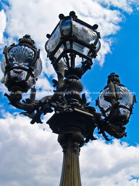 """Ornate old fashioned street lamps, close-up, Paris. SEE ALSO:   <a href=""""http://www.blurb.com/b/893039-paris-international-city"""">http://www.blurb.com/b/893039-paris-international-city</a>"""