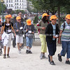 """School children on tour. in their orange caps. Paris, International City.<br /> Model released; no, for editorial & personal use. SEE ALSO:   <a href=""""http://www.blurb.com/b/893039-paris-international-city"""">http://www.blurb.com/b/893039-paris-international-city</a>"""