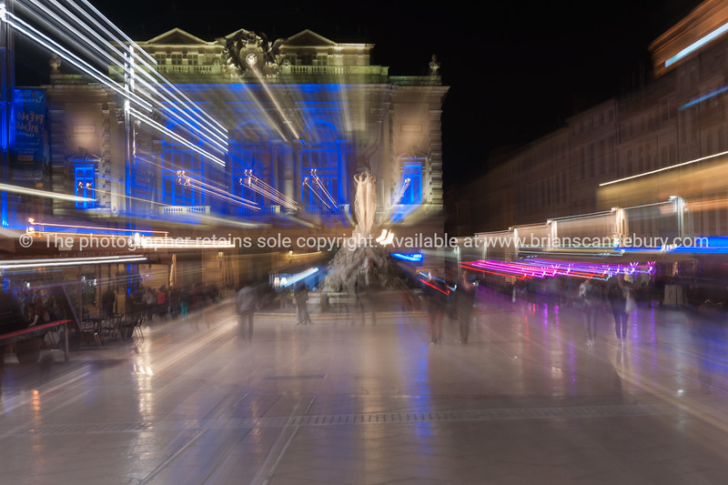 Zoom blur images at night in the Place de la Comédie wonderful architecture and Three Graces fountain on  promenade under night lights and long exposure Place de la Comédie Montpellier France