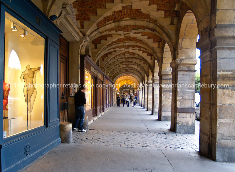 "Arched walkway, ""Place des Vosges"", Paris, International City. SEE ALSO:   <a href=""http://www.blurb.com/b/893039-paris-international-city"">http://www.blurb.com/b/893039-paris-international-city</a>"