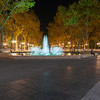 Illuminated fountain and tree lined promenade long exposure night scene at end of Place de le Comedie Montpellier France urban & architectural