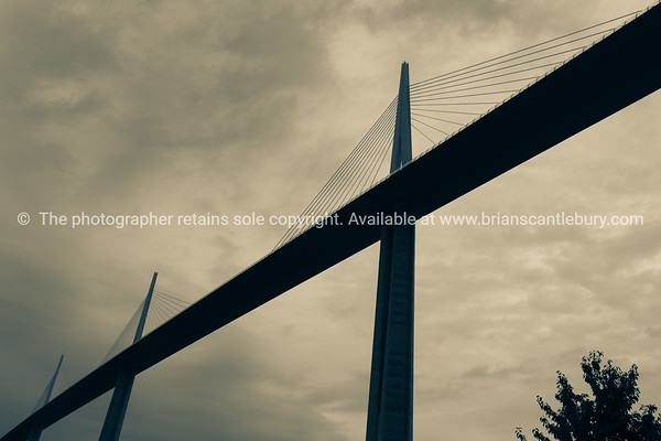 Split tone cable span bridge image from low point view Millau Bridge France