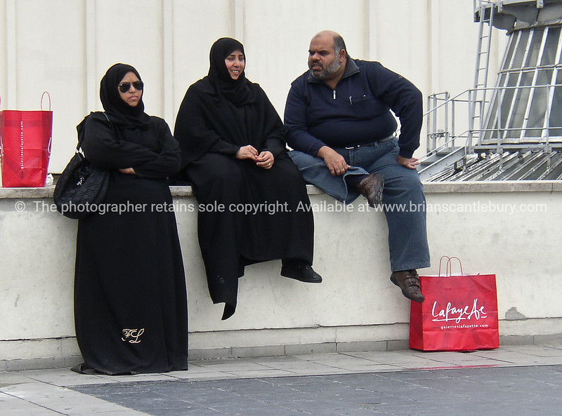 """Shoppers, resting after the spend, Muslims on La fayette rooftop. Paris, International City.<br /> Model released; no, for editorial & personal use. SEE ALSO:   <a href=""""http://www.blurb.com/b/893039-paris-international-city"""">http://www.blurb.com/b/893039-paris-international-city</a>"""