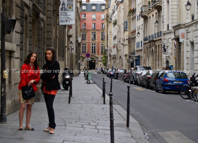 """Street scene, two women, Paris, International City.<br /> Model released; no, for editorial & personal use. SEE ALSO:   <a href=""""http://www.blurb.com/b/893039-paris-international-city"""">http://www.blurb.com/b/893039-paris-international-city</a>"""