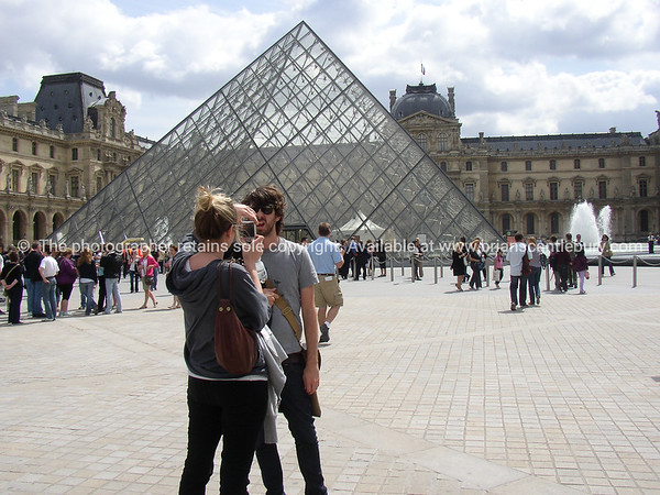 """Tourists pose in front of Louvre, Paris, International City. SEE ALSO:   <a href=""""http://www.blurb.com/b/893039-paris-international-city"""">http://www.blurb.com/b/893039-paris-international-city</a>"""