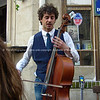 "Cellist playing on street corner, Paris, International City.<br /> Model released; no, for editorial & personal use. SEE ALSO:   <a href=""http://www.blurb.com/b/893039-paris-international-city"">http://www.blurb.com/b/893039-paris-international-city</a>"