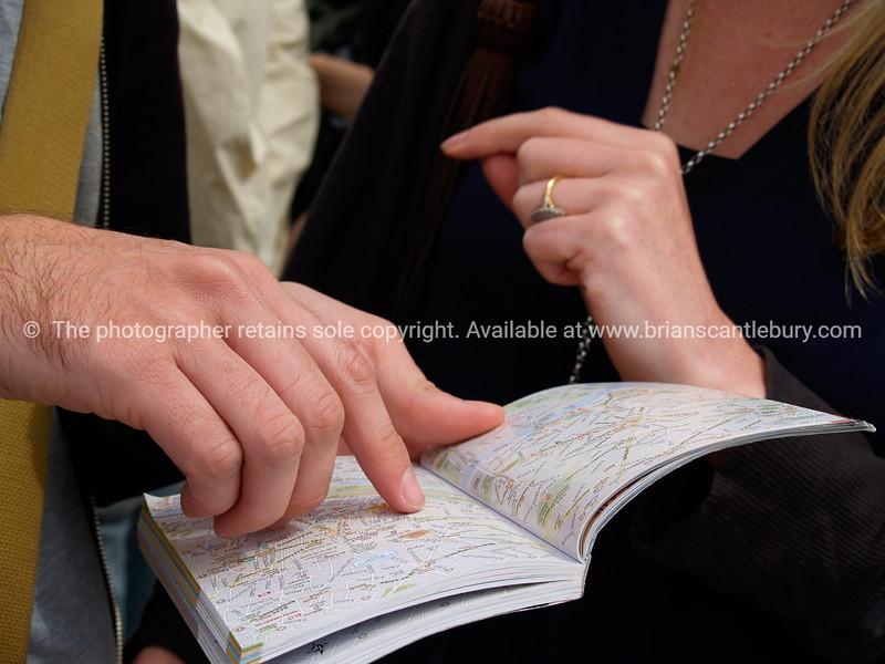 "Checking the map, tourists check map of Paris. SEE ALSO:   <a href=""http://www.blurb.com/b/893039-paris-international-city"">http://www.blurb.com/b/893039-paris-international-city</a>"