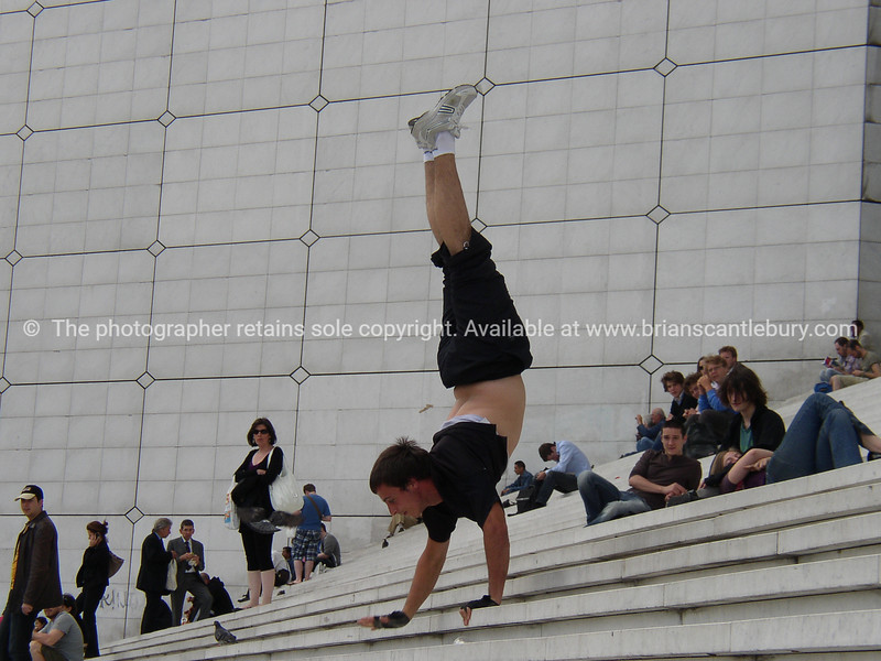 """Hand walker on Le Grande Arche steps. Paris, France.<br /> Model released; no, for editorial & personal use. SEE ALSO:   <a href=""""http://www.blurb.com/b/893039-paris-international-city"""">http://www.blurb.com/b/893039-paris-international-city</a>"""