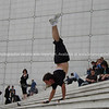 "Hand walker on Le Grande Arche steps. Paris, France.<br /> Model released; no, for editorial & personal use. SEE ALSO:   <a href=""http://www.blurb.com/b/893039-paris-international-city"">http://www.blurb.com/b/893039-paris-international-city</a>"