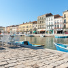 Sete, France, Royal Canal boats and surrounding buildings.