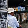 "Street vendor of magazines,photographs,music. Paris, International City. SEE ALSO:   <a href=""http://www.blurb.com/b/893039-paris-international-city"">http://www.blurb.com/b/893039-paris-international-city</a>"