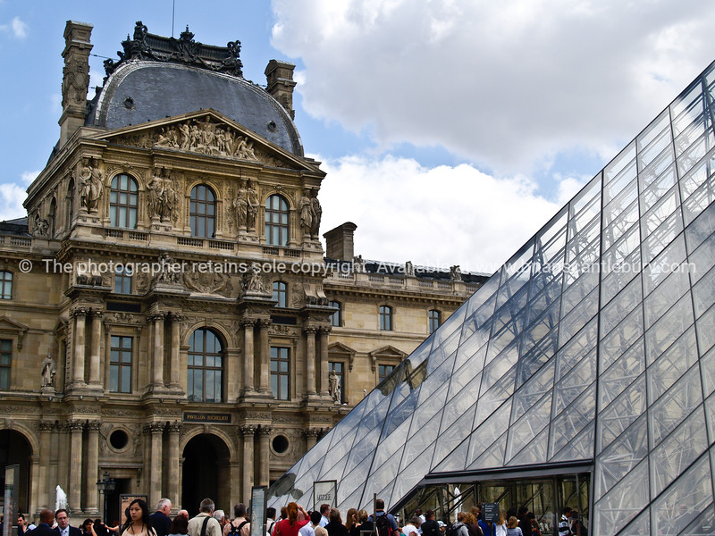 "Louvre. Traditional architecture contrasts with the modern glass Pyramide. Paris, International City. SEE ALSO:   <a href=""http://www.blurb.com/b/893039-paris-international-city"">http://www.blurb.com/b/893039-paris-international-city</a>"