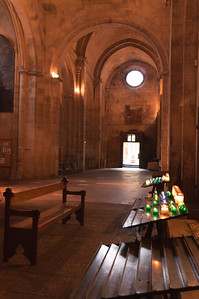 Centuries old cathedral in France - Candles lit.