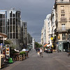street scene near Pompidou Center. the sun was shining but the sky was dark.