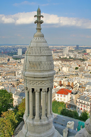 The Sacré-Cœur is built of Château-Landon (Seine-et-Marne) stone, a frost-resistant travertine that constantly weathers out its calcite, so that it bleaches with age to a chalky whiteness.
