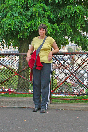 Judy resting against the fence on Rue du Cardinal Dubois - we still had a long walk back ahead of us.