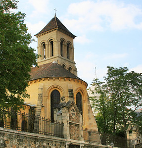 On the left of the Sacred Heart is St Peter's church of Montmartre - consecrated on 21 April 1147.