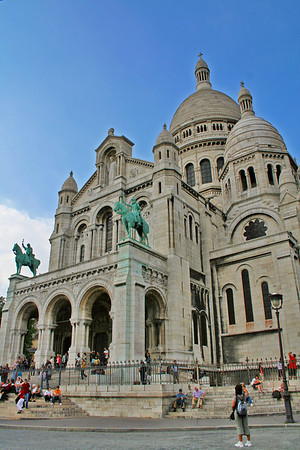 Our first view of the Sacre Coeur, after walking up many, many steps from a street below. You can see the two bronze equestrian statues of St Joan of Arc and King Saint Louis IX.