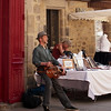 Hurdy gurdy man playing on the streets of Dinan