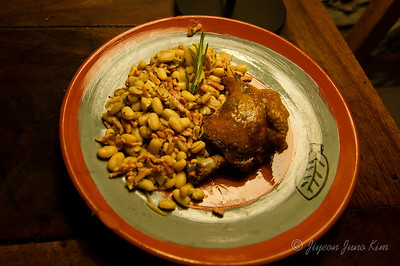 Duck config and peas with rosemary and bacon