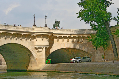 Part of Pont Neuf the oldest standing bridge in Paris. The decision to build the bridge was made by King Henri III, who laid its first stone in 1578. After a long delay, due in part to the Wars of Religion, it was completed under the reign of Henri IV, who inaugurated it in 1607.