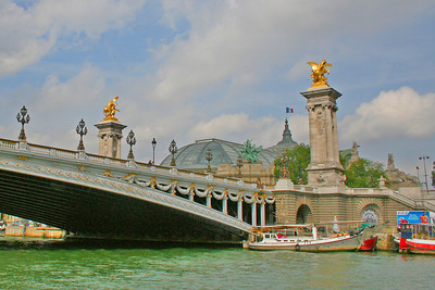 Pont Alexandre III is an arch bridge that spans the Seine, connecting the Champs-Élysées quarter and the Invalides and Eiffel Tower Quarter, regarded by many as one of the prettiest in Paris.